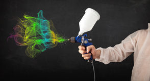 Painter working with airbrush and paints colorful paint Stock Photography
