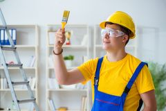 The painter working at home in refurbishment project. Painter working at home in refurbishment project Stock Photo