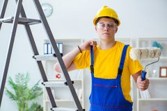 The painter working at home in refurbishment project. Painter working at home in refurbishment project Stock Image