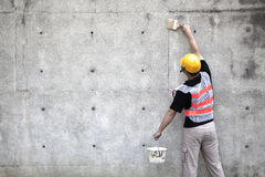 Painter working on the old  wall Stock Images