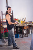 Painter working in studio Royalty Free Stock Photo