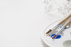 Painter workplace with watercolor pallete anr other tools Royalty Free Stock Images