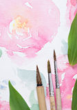 Painter workplace with watercolor pallete anr other tools Stock Photos