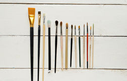 Painter workplace with watercolor pallete anr other tools Royalty Free Stock Photos