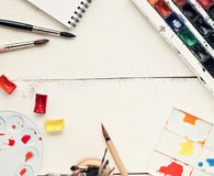 Painter workplace with watercolor pallete anr other tools Royalty Free Stock Photography