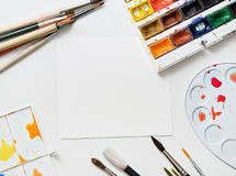 Painter workplace with watercolor pallete anr other tools Stock Photography