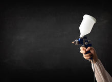 Painter works with airbrush gun and empty copyspace Stock Image