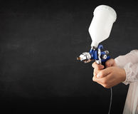 Painter works with airbrush gun and empty copyspace Royalty Free Stock Image
