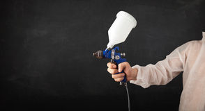 Painter works with airbrush gun and empty copyspace Stock Photos