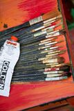 Painter's brushes and paint tube Royalty Free Stock Images