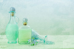 Painterly bottles of bath oil Stock Photos