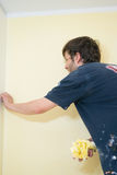 Painters and decoraters. Real painters and decorates during their work, painting the walls of the apartment and doing the repairs on the walls Stock Image