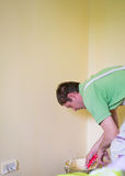 Painters and decoraters. Real painters and decorates during their work, painting the walls of the apartment and doing the repairs on the walls Royalty Free Stock Photo
