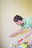 Painters and decoraters. Real painters and decorates during their work, painting the walls of the apartment and doing the repairs on the walls Stock Photography