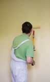 Painters and decoraters. Real painters and decorates during their work, painting the walls of the apartment and doing the repairs on the walls Royalty Free Stock Image
