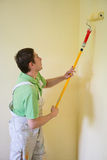 Painters and decoraters. Real painters and decorates during their work, painting the walls of the apartment and doing the repairs on the walls Stock Images
