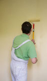 Painters and decoraters. Real painters and decorates during their work, painting the walls of the apartment and doing the repairs on the walls Stock Photos