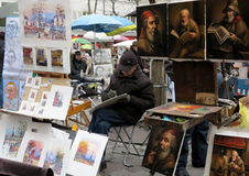 Painters in Place du Tertre in Paris. Painters displaying their paintings and drawings in Place du Tertre in Paris, France Stock Images