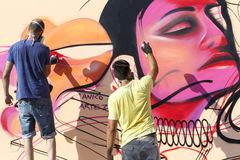 Painters graffiti during the course of Street Art Festival Thess Stock Image
