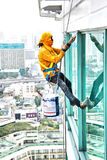 Painters high building condo outdoors sprinkle. With rope safe sure in bangkok thailand Stock Photo