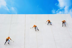 Painters high building condo outdoors sprinkle. With rope safe sure in bangkok thailand Stock Image