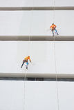 Painters high building condo outdoors sprinkle. With rope safe sure in bangkok thailand Stock Photography