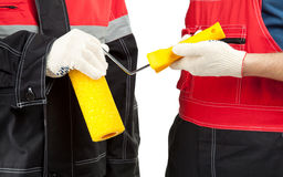 Painters holding paint roller Stock Photos