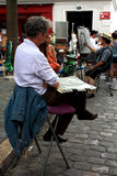 Painters at Montmartre, Paris. Picture taken in Paris, at Montmartre village, on July 2011 Stock Photos
