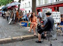 Painters at Montmartre, Paris. Picture taken in Paris, at Montmartre village, on July 2011 Royalty Free Stock Photo