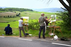 Painters paint outdoors. On a Tuscan landscape Royalty Free Stock Images