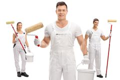 Painters with paint rollers and buckets Royalty Free Stock Photo