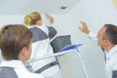 Painters painting the ceiling. Stain Stock Image