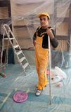 Painters painting construction worker Stock Images