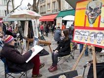 Painters in Place du Tertre Paris. Painters painting their paintings and drawings in Place du Tertre in Paris, France Royalty Free Stock Photography