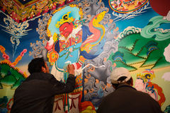 Painters painting on the wall in Hemis gompa Stock Photos