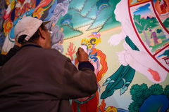 Painters painting on the wall in Hemis gompa Royalty Free Stock Photography