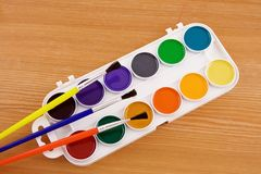 Painters palette with brush Stock Photos