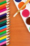 Painters palette with brush and pencils Royalty Free Stock Photography