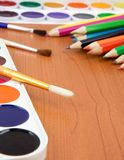 Painters palette with brush and pencils Royalty Free Stock Image
