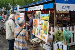 Painters at the Place du Tertre in the historic district of Montmartre in Paris stock photos