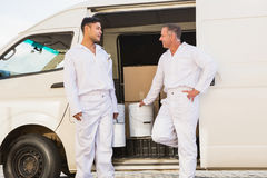 Painters smiling leaning against their van Royalty Free Stock Photography
