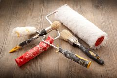 Painters Tools in wooden background. Painters Tools on wooden background Royalty Free Stock Images