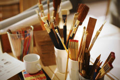 Painters tools at the workplace. Painters tools in the artist studio Royalty Free Stock Photo