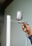 Painters were spray painting steel frame Stock Photo