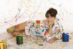 Painting. Model Release 353 Woman in mid 20s having fun making a mess painting royalty free stock photography