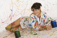 Painting. Model Release 353  Woman in mid 20s having fun making a mess painting Stock Image