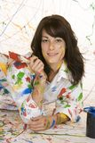 Painting. Model Release 353  Woman in mid 20s having fun making a mess painting Royalty Free Stock Photo