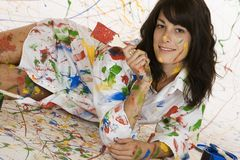 Painting. Model Release 353  Woman in mid 20s having fun making a mess painting Royalty Free Stock Photos