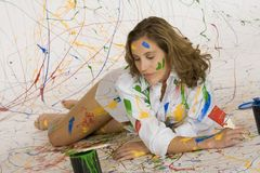 Painting. Model Release 353  Woman in mid 20s having fun making a mess painting Stock Images