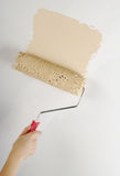 Painting. Hand painting with roller on white wall Stock Photo